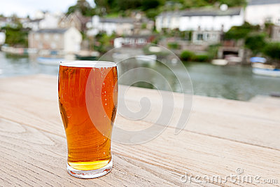 Pint of Real Ale outside a Riverside Village Pub