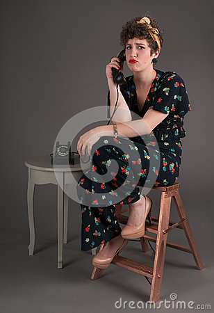 Pinup Girl in Flowered Outfit Bored on the Phone