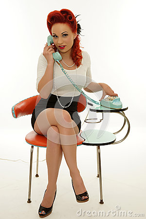Pinup woman holding a vintage telephone