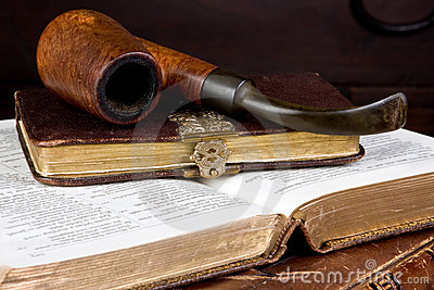 Pipe and books