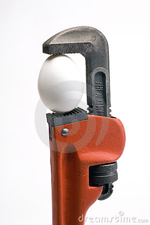 Pipe wrench with an egg in it s jaws