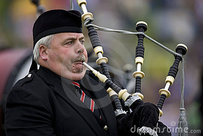 Piper - Highland Games - Scotland Editorial Stock Photo