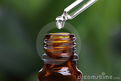 Pipette and bottle of essential oil