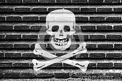Pirate flag on an old brick wall