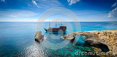 Pirate ship by rock arch,cyprus Editorial Image