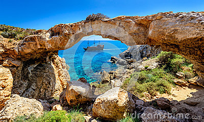 Pirate ship through rock arch,cyprus
