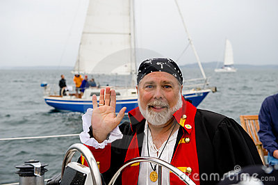 Pirate skipper at helm of boat