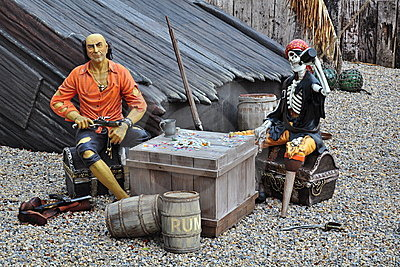 Pirates on broken ship, treasure chest, skeleton Editorial Image