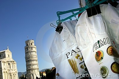 Pisa, the leaning tower and Italian pasta cook caps