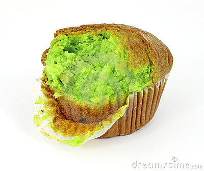 Pistachio nut muffin that has had one bite
