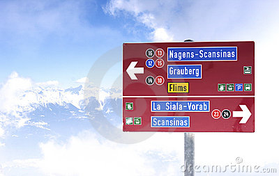 Piste sign at the top of a mountain