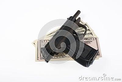 Pistol and dollars