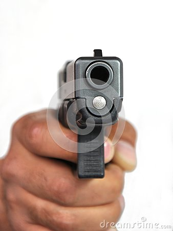 Pistol in a man s hand on a white background.