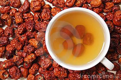 Pitted chinese jujubes with a cup of jujube tea