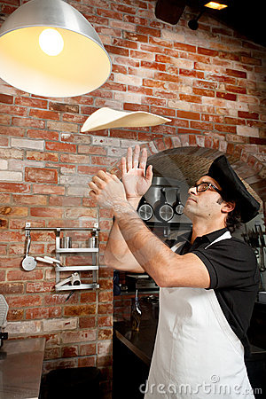 Pizza Chef playing with Pizza Dough