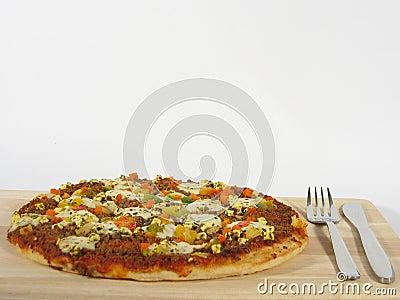 Pizza com cutelaria