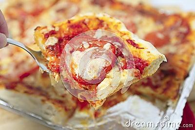 Pizza de la porción horizontal
