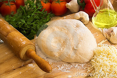 Pizza dough and rolling pin