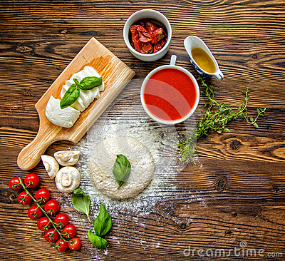 Free Pizza Dough With Tomato Sauce On Wooden Table Stock Photos - 73532463