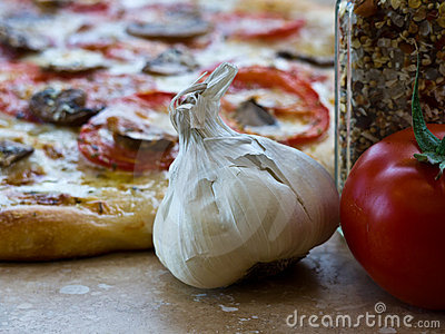 Pizza ingredients garlic bulb, tomato, spices