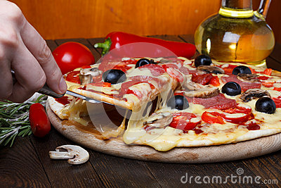 Pizza on lifter with melting cheese
