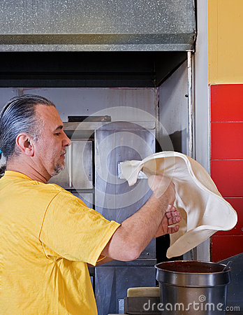 Free Pizza Maker Tossing Dough Royalty Free Stock Photo - 46270705