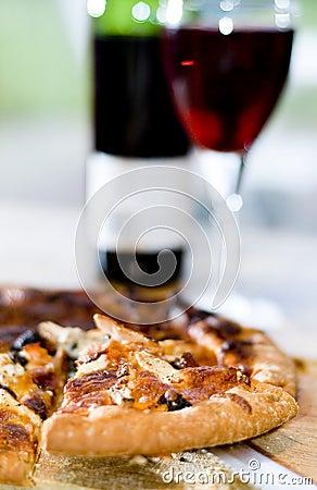 Pizza slice and wine