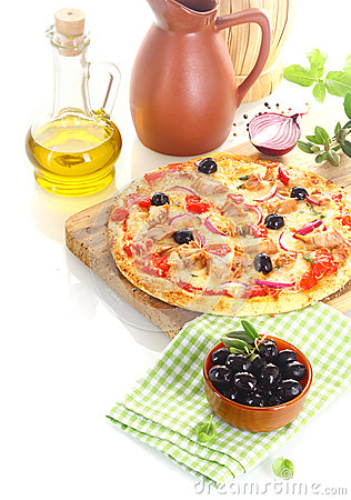 Pizza surrounded by the ingredients