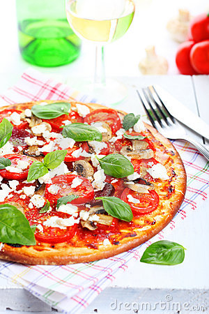Pizza with tomatoes and mushrooms