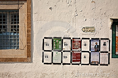 Places fot election posters on the wall in Tunis Editorial Stock Photo