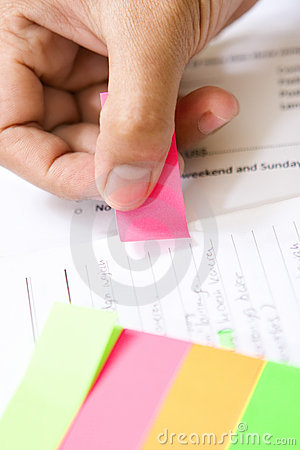 Placing colorful tag on book