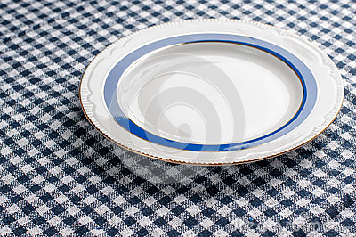 Plaid tablecloth and a plate