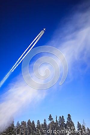 Plane in blue sky.