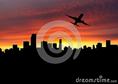 Plane departing Miami at sunset