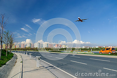 Plane landing with blue sky