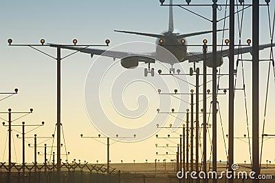 Plane over runway