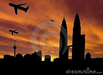 Planes departing Kuala Lumpur at sunset