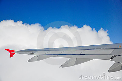 Planes wing through the clouds