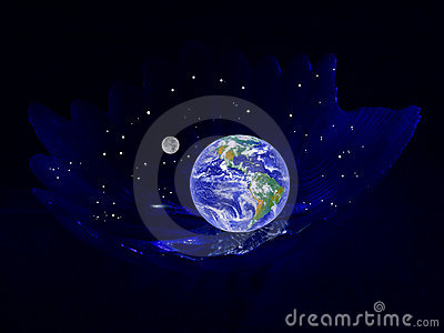 Planet the Earth in a cradle