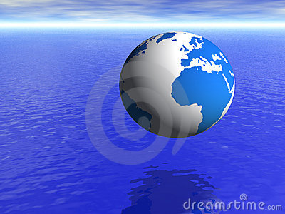 Planet earth globe over blue ocean and cloudy sky