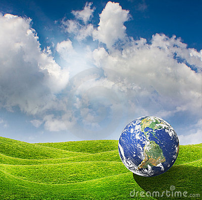 Planet Earth on a green meadow