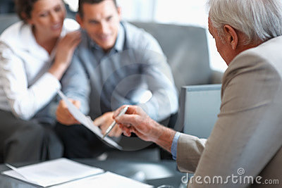Planner explaining investment plans to clients