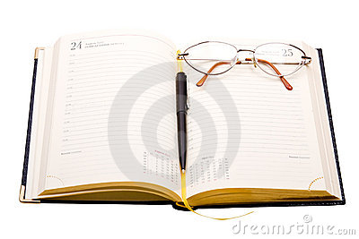 Planner with glasses and pen on white