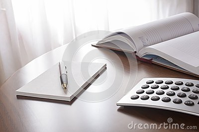 Planner with  pen and calculator