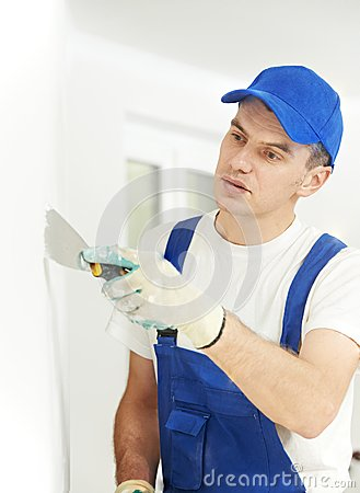 Free Plasterer With Putty Knife At Wall Filling Stock Photos - 34161503
