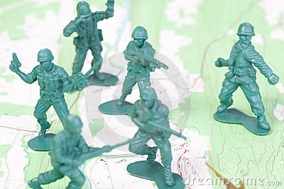 Plastic Army Men Fighting On Topographic Map. Royalty Free Stock Photos - Image: 18451768