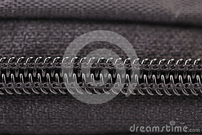 Plastic black zipper of case. Macro.