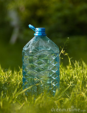 Plastic bottle of water on the grass