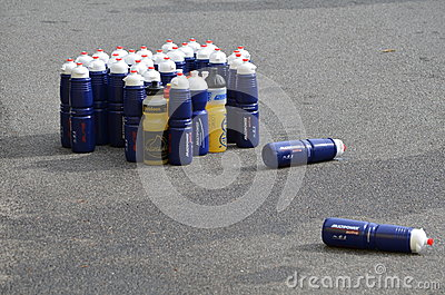 Plastic bottles with energy drink at a triathlon Editorial Stock Photo