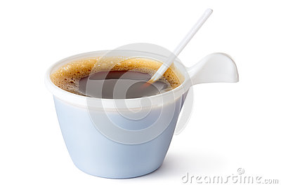 Plastic coffee mug with a spoon
